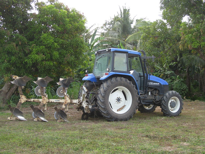 Learn how to make rows in a garden with a tractor