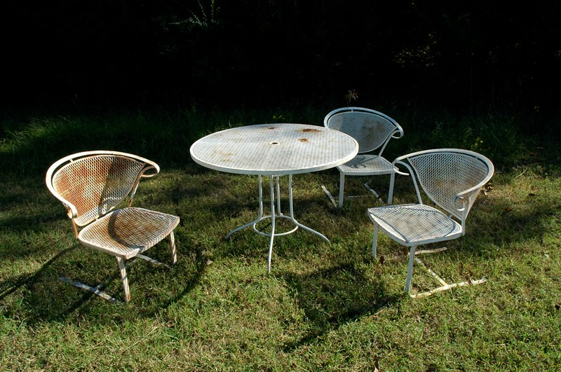 Patio furniture on grass or outside of grass?